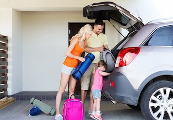 family packing car for a road trip